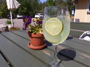 Refreshing summer drink at På Krogen Restaurant's terrace table.
